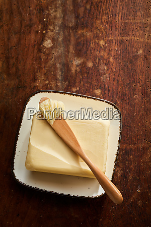 ceramic butter dish with pat of