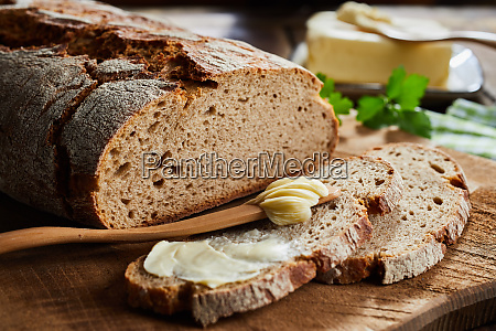 buttered slice of rye bread with