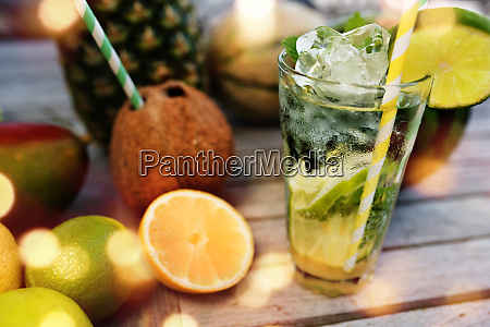 mojito cocktail and tropical fruits