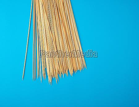 wooden bamboo chopsticks on a blue