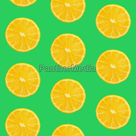 seamless pattern of oranges on green