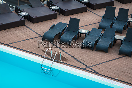 swimming pool and deck chairs for
