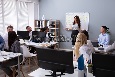 young businesswoman giving presentation to her