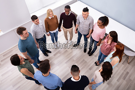 multi ethnic people standing in circle