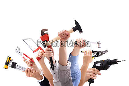 group of peoples hand holding carpentry