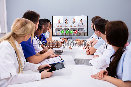 team of professional doctors having video