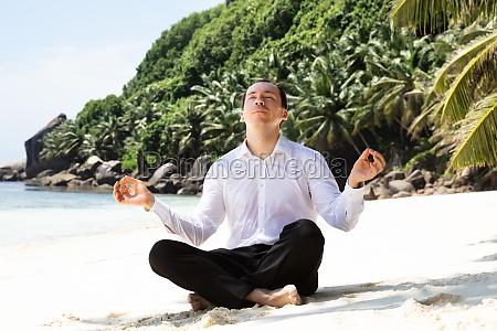 man in formalwear sitting on the
