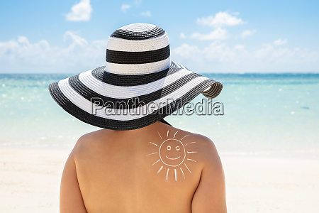 sun drawn with sunscreen lotion on