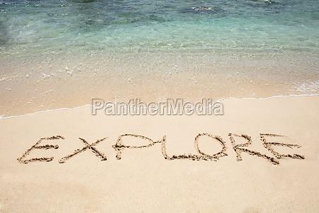 explore text written on sand near