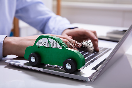 green car on laptop keypad
