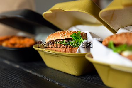 hamburger in a takeaway container on