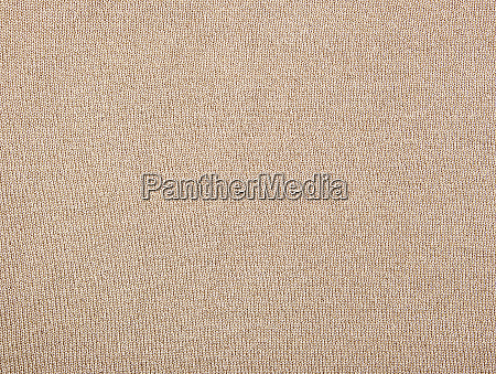 fragment of golden cotton fabric for