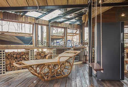 rattan reclining chair in country interior