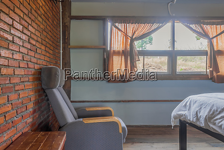 arm chair in country loft interior