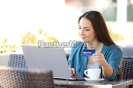 woman paying online with a laptop