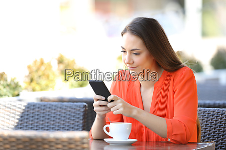 serious woman is using a smart
