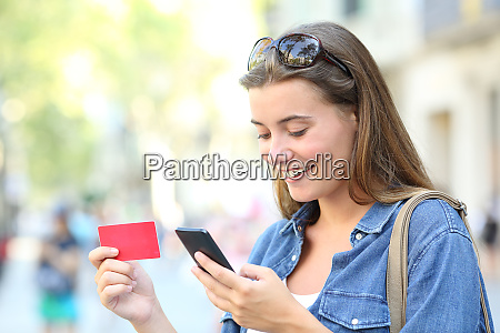 happy teen buying online with a