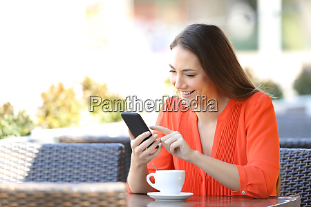 happy woman is browsing a smart