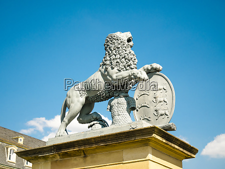 lion statue neues schloss behind the
