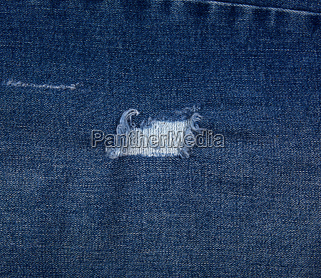 fragment of blue jeans fabric with