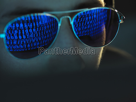 cyber crime reflection in spectacles of