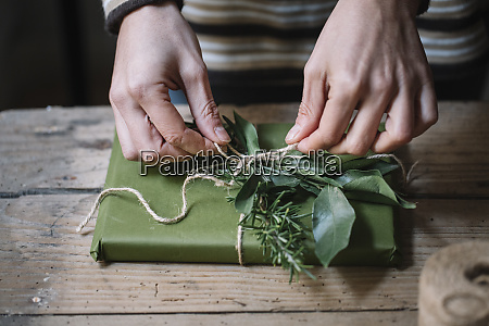 womans hands wrapping present