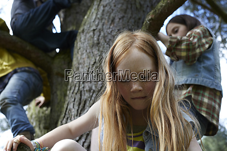 redheaded girl with friends climbing in