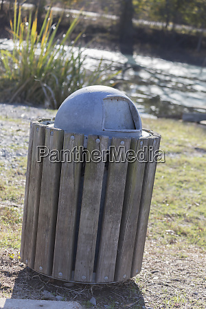 metal and wooden garbage can
