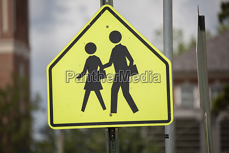 school zone and crosswalk sign