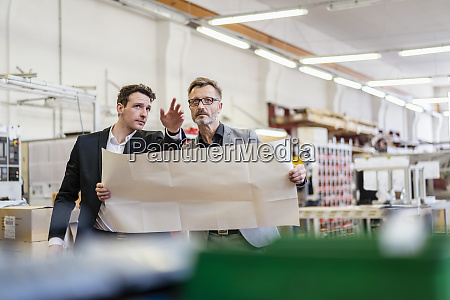 two businessmen discussing plan in a