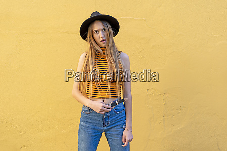 portrait of annoyed teenage girl wearing