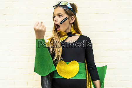 girl in super heroine costume with