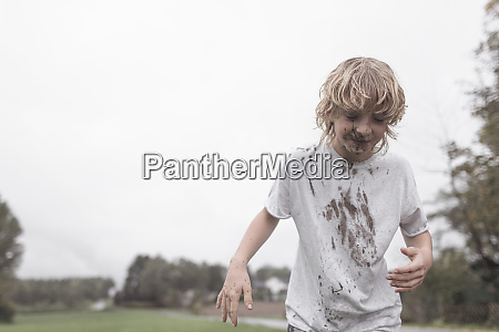 portrait of blond boy with dirty