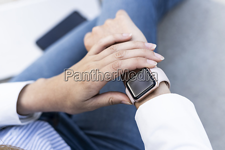 businesswoman checking smartwatch close up