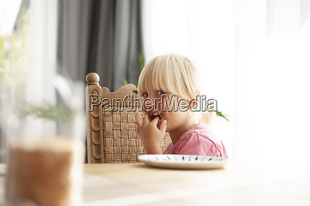 portrait of tricksy little girl sitting