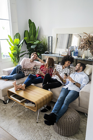 friends sitting on couch working casually
