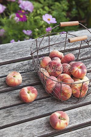 wire basket of doughnut peaches on