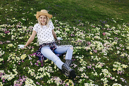 young woman is sitting in flower