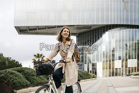 portrait of woman riding e bike
