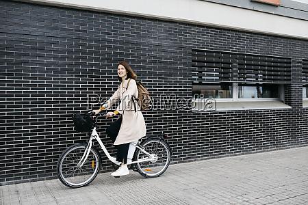 woman riding e bike along a