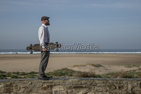 man with longboard standing on a
