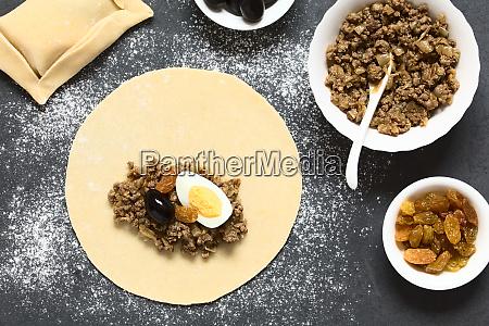 preparing chilean empanada de pino