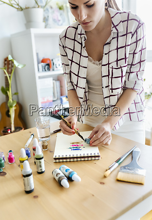 woman applying colour pigments at colouring