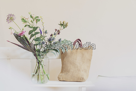 flower vase and open calendar on
