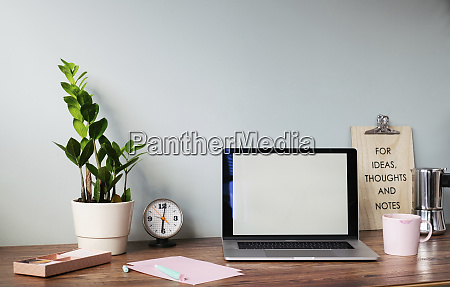 desk with laptop at home office