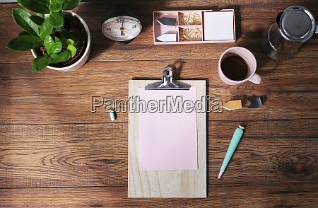 clip board with blank pink paper