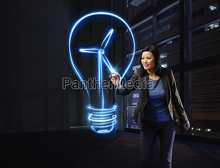 businessman painting lightbulb with a wind