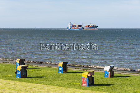 germany cuxhaven huge cargo boats passing