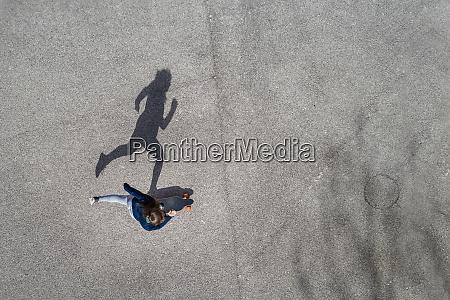 woman longboarding top view