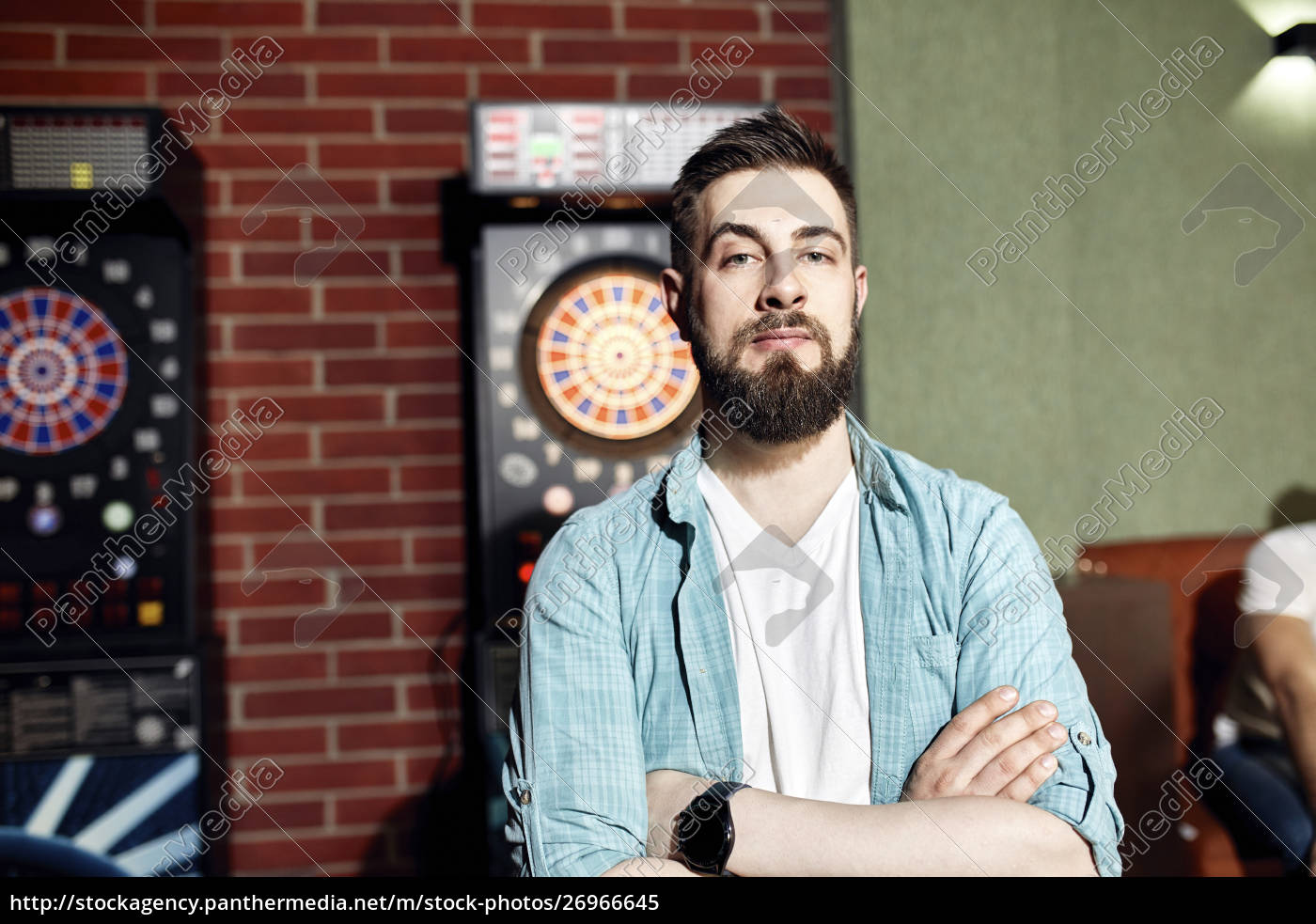 portrait, of, confident, man, at, dartboard - 26966645